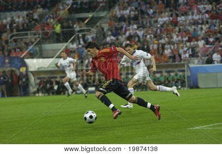 INNSBRUCK - JUNE 10: Villa (in red) & Semshov (in white) during the match Spain-Russia 4:1 Euro2008 Group D. June 10, 2008, in Innsbruck, Austria