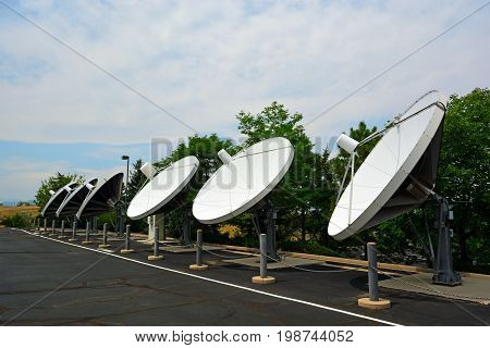 Array of Large Satellite Dishes on a Sunny Day