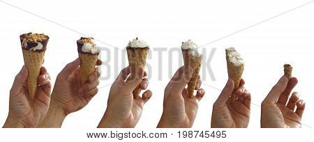 Sequence of an ice cream being eaten step by step. Man's hand holding a chocolate covered vanilla ice cream cone with peanut on white background