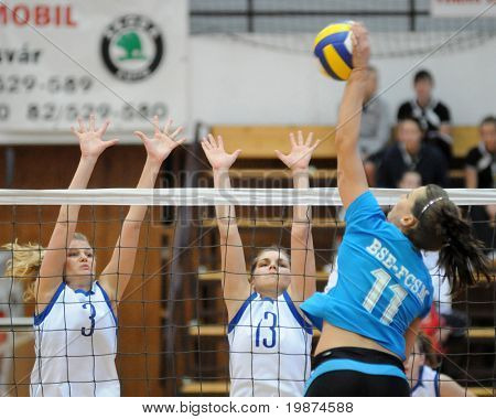 KAPOSVAR, HUNGARY - MARCH 1: Gabriella Kondor and Gabriella Serak blocks the ball in the Hungarian Extra League woman volleyball game between Kaposvar and BSE-FCSM , March 1, 2009 in Kaposvar, Hungary