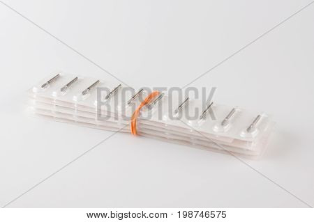 New dental burs in the package for sawing teeth
