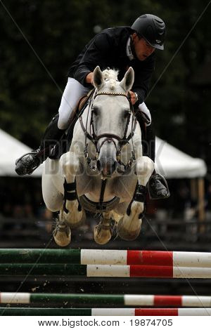 KAPOSVAR, HUNGARY - JULY 18: An unidentified competitor jumps with his horse on Hungarian Jumping Championship Final for adult riders, July 18, 2009 in Kaposvar, Hungary