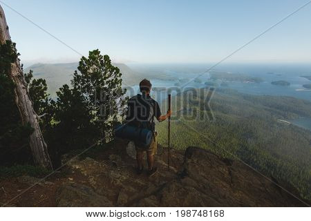 Man Standing On The Cliff With View On Ocean And Islands