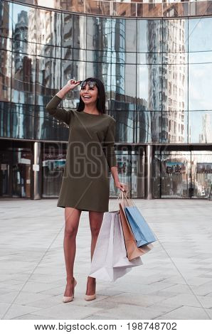 Shot of a young woman out on a shopping spree