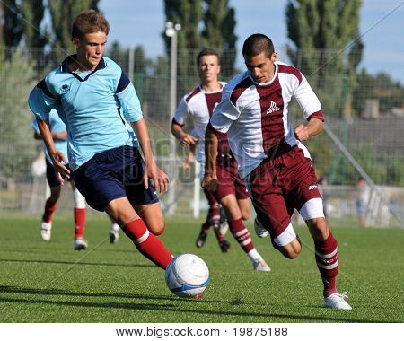 KAPOSVAR, HUNGARY - JULY 25: Unidentified players in action at the V. Youth Football Festival Under 19 Final Rakoczi FC (HUN) vs Toponar (HUN) July 25, 2009 in Kaposvar, Hungary