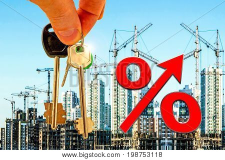 The symbol percent on a background of keys of the apartment and construction .The concept of mortgage lending .