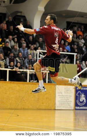 NAGYATAD, HUNGARY - FEBRUARY 5: Gergo Ivancsik (with the ball) in action at Hungarian Cup Handball match (Nagyatad vs. Veszprem) February 5, 2009 in Nagyatad, Hungary.