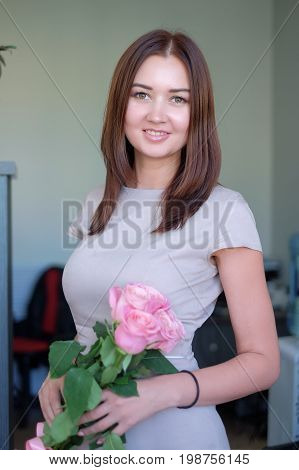 Flower delivery to the office. woman holding beautiful bouquet