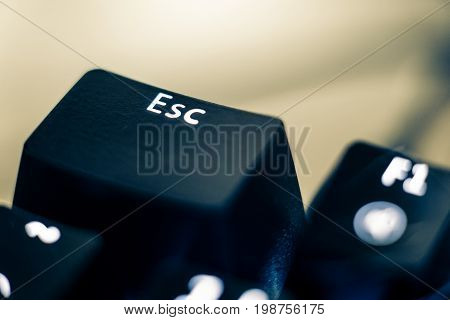 Macro photo of the escape key on a mechanical switch keyboard. The