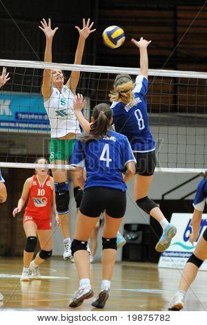 KAPOSVAR, HUNGARY - DECEMBER 17: Timea Kondor (blue 8) strikes the ball at the Hungarian Extra League woman volleyball game between Kaposvar and Miskolc , December 17, 2008 in Kaposvar, Hungary.