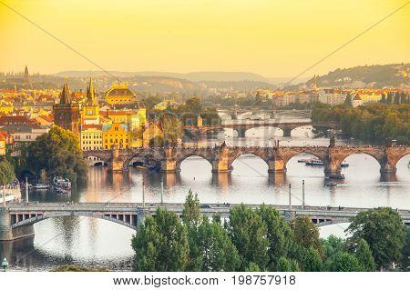 Prague bridges over Vltava river at sunset time, Czech Republic.