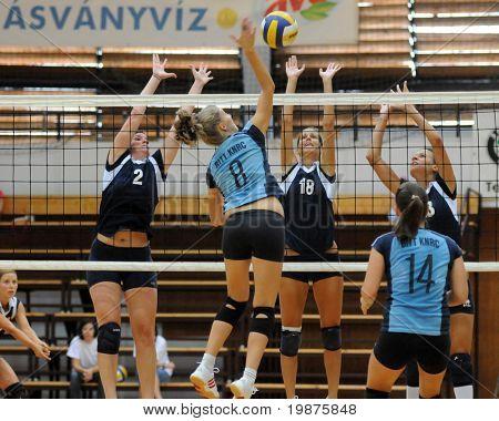 KAPOSVAR, HUNGARY - SEPTEMBER 13: Timea Kondor (8) strikes the ball at the Hungarian Extra League woman volleyball game Kaposvar vs TFSE, September 13, 2009 in Kaposvar, Hungary