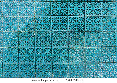Background of green modular plastic floor tiles