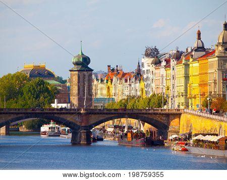 Masaryk Embankment with and Sitkovska water tower Palacky Bridge over Vltava River in Prague city centre, Czech Republic.