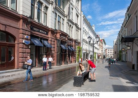 MOSCOW - AUGUST 7: People in Stoleshnikov Lane on August 7 2017 in Moscow. Stoleshnikov lane is pedestrian street in the center of Moscow.