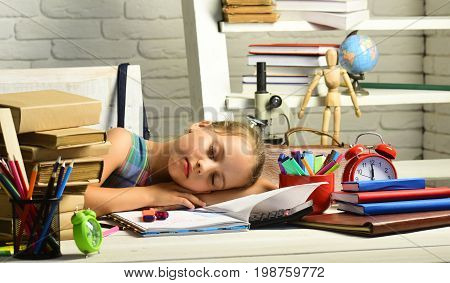 Kid Near Pile Of Textbooks And School Supplies, Brick Background
