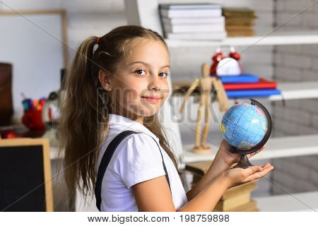 Kid Studies Geography. Girl With Happy Face Expression