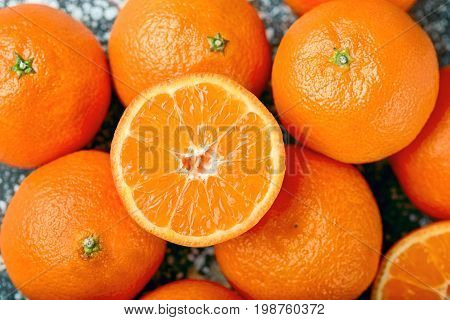 Delicious and beautiful Tangerines. Peeled Tangerine orange and Tangerine orange slices on a Dark Background. Citrus background,