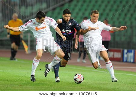 BUDAPEST - SEPTEMBER 29: Fodor (L) Enderson (C)and Bodnar in action at the UEFA Champions League football game Debrecen vs Lyon, September 29, 2009 in Budapest, Hungary.