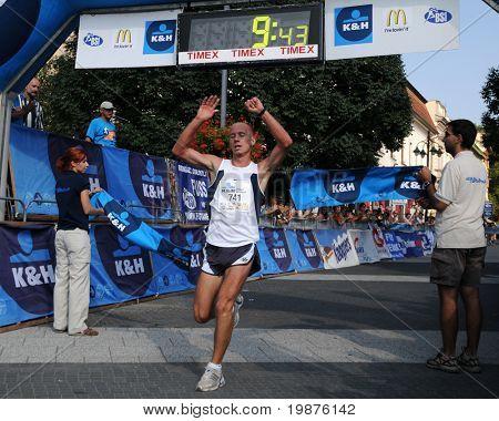KAPOSVAR, HUNGARY - SEPTEMBER 20: Tamas Nagy celebrates at the finish line during the K&H Running Day running race September 20, 2009 in Kaposvar, Hungary.