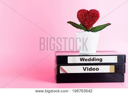 Video Tape for Wedding Video with love flower and pink copy space