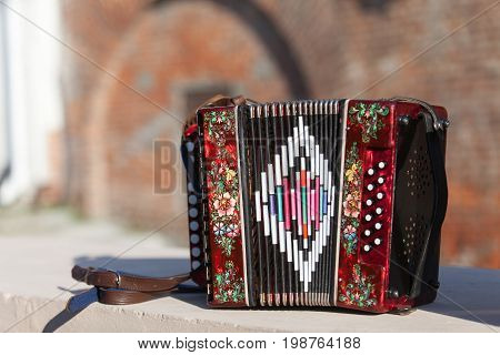 Classic Musical Instrument An Accordion In Red Color