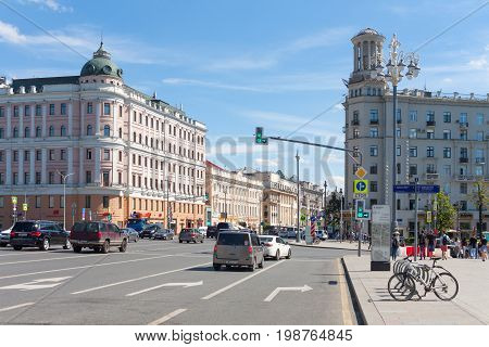 MOSCOW - AUGUST 7: Logunov apartment house (left) and residential house (right) on Tverskaya Street on August 7 2017 in Moscow. Tverskaya Street is located in the center of Moscow.