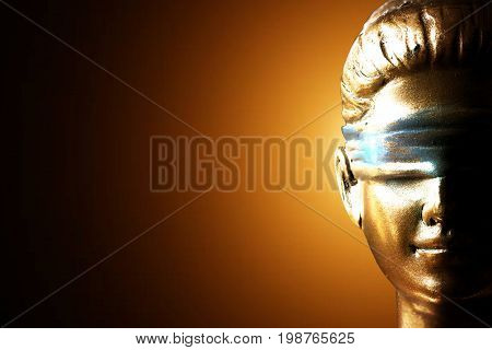 Lady justice isolated against golden background (Symbol of justice)