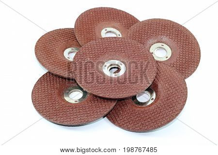 Stack of abrasive disks stone for metal grinding isolated on white background