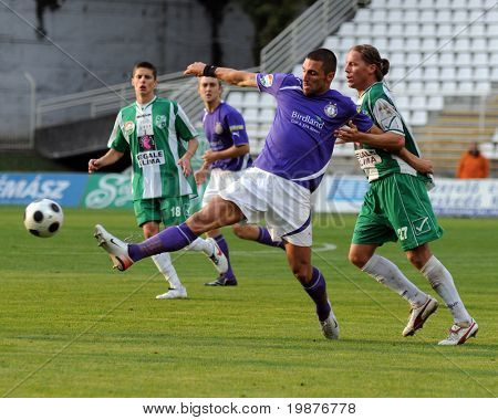 KAPOSVAR, HUNGARY - OCTOBER 17: Attila Simon (2nd from R) in action at a Hungarian National Championship soccer game Kaposvar vs Ujpest October 17, 2009 in Kaposvar, Hungary.