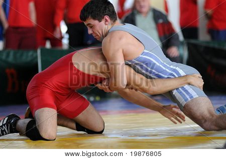 KAPOSVAR, HUNGARY -OCTOBER 18: Two competitors wrestle in the Hungarian Wrestling Team Championship, October 18, 2009 in Kaposvar, Hungary.