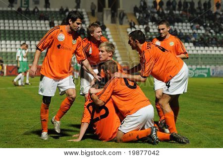 KAPOSVAR, HUNGARY - OCTOBER 28: Gyor players celebrate a goal at a Hungarian National Cup soccer game Kaposvar vs Gyor October 28, 2009 in Kaposvar, Hungary.