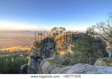 Top of the rock in light of the setting sun Bohemian Paradise Czech Republic