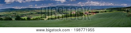 Typical Pastoral View On Green Meadows, Castles, Railway And Small Factories In Switzerland