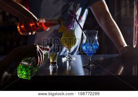 Barmans at work preparing cocktails. concept about service and beverages