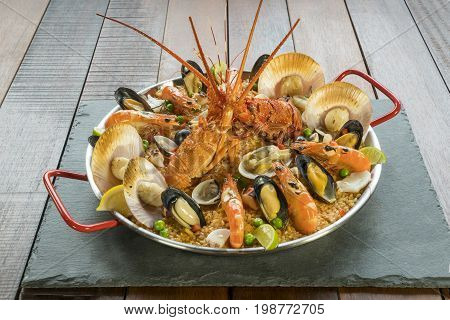 Paella With Fresh Lobster, Scollops, Mussels And Prawn