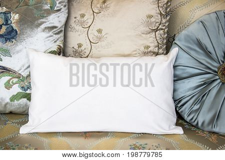 White lumbar pillow on an armchair case Mockup. Interior photo classix oriental shabby chic