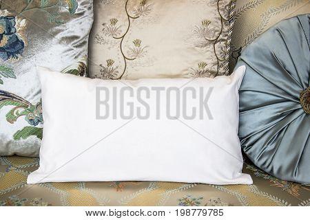 White lumbar pillow on an armchair case Mockup. Interior photo classix oriental shabby chic