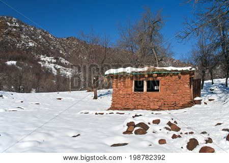 Hut in the mountains of Tajikistan. Temporary housing in the tract Sarihosor winter in December after a snowfall.