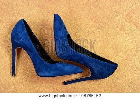High Heel Shoes On Faded Orange Background. Formal Footwear