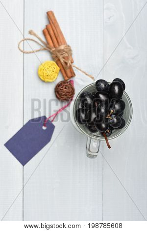 Bunch Of Black Grapes In Glass With Handle, Top View