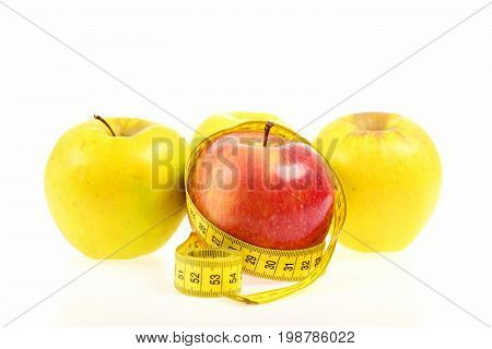 Apples Of Red And Yellow Colors Wrapped With Measuring Tape