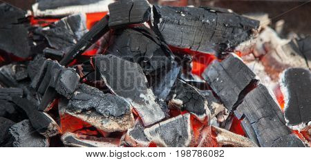 black charcoal crimson fire erupted in the BBQ