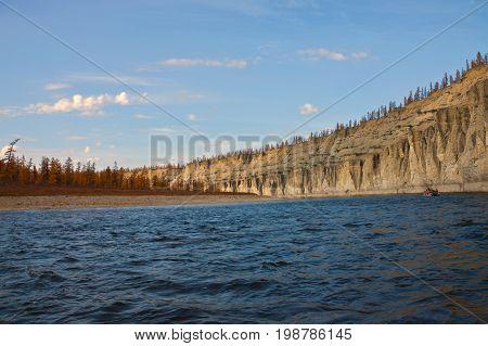Sailing in boat in the Siberian taiga river in the fall. Moiyero river Evenkia Krasnoyarsk region Russia