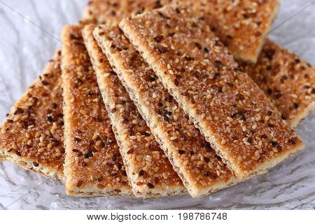 Sesame cakes with cocoa and sugar on glass plate
