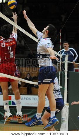 KAPOSVAR, HUNGARY - JANUARY 22: Guilherme (L) and Skoric (C) in action at a Middle European League volleyball game Kaposvar (HUN) vs. HotVolleys Wien (AUT), January 22, 2010 in Kaposvar, Hungary.