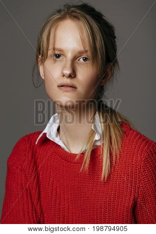 Fashion photo of beautiful lady in white shirt and red pullover gray backgroundstudio