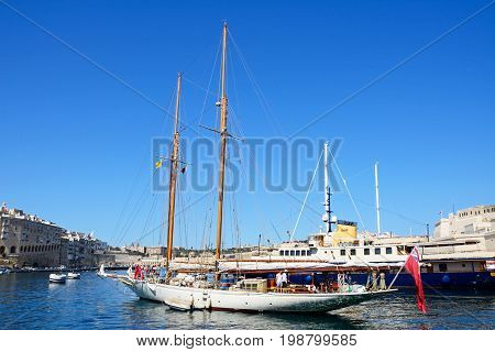VITTORIOSA, MALTA - MARCH 31, 2017 - View of yachts moored in the marina with views towards Senglea to the left and Valletta to the rear Vittoriosa Malta Europe, March 31, 2017.