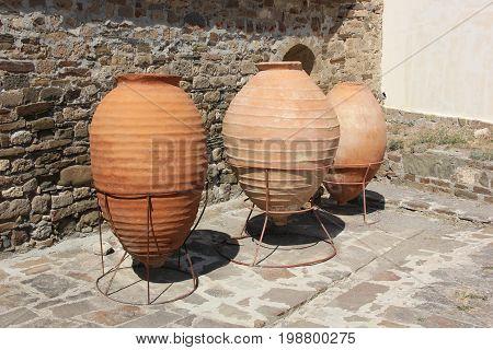 Three large earthen vessels inside the fortress in Sudak Crimea