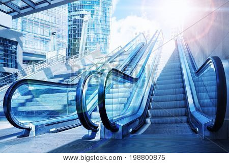 two escalators against a sunny blue sky